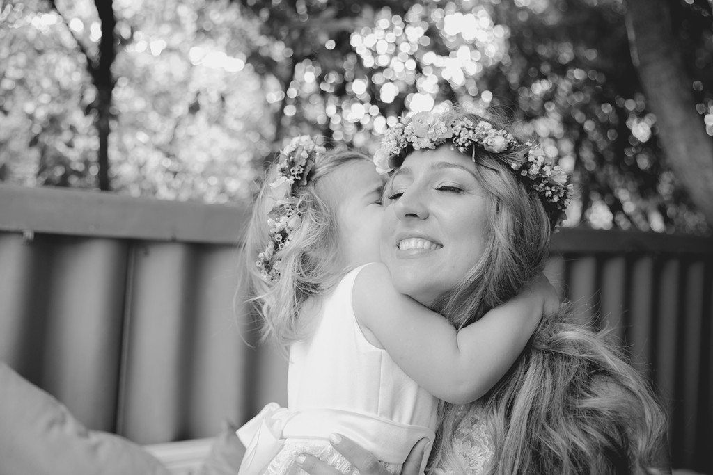 candid moment of the bride with her daughter