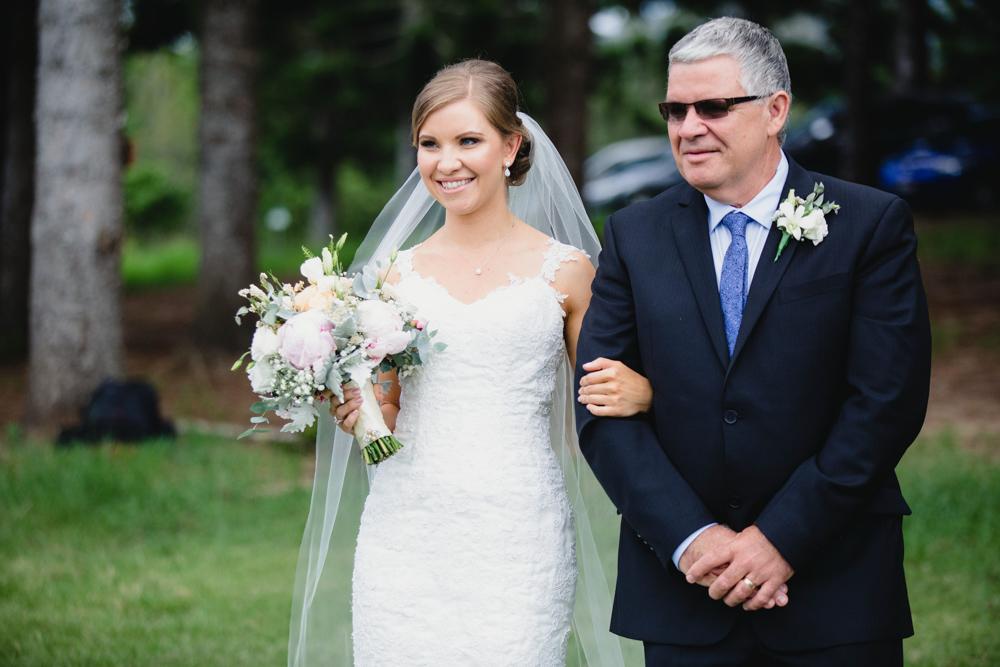 bride walking down isle on wedding day