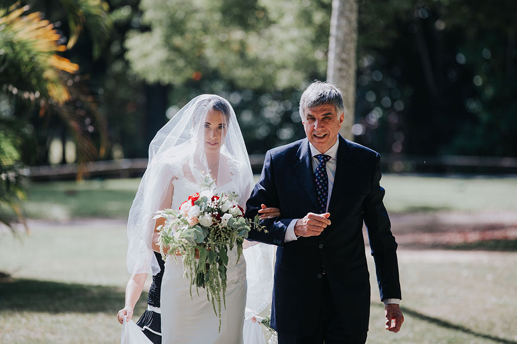 bride and father walking down isle on wedding day